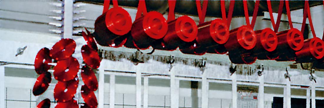 Eloxier-Straße mit rot eloxierten Bauteilen